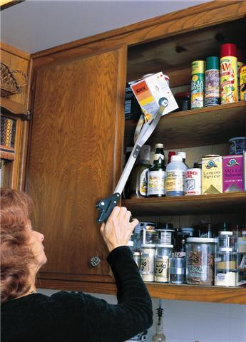 woman reaching for item on high shelf with reacher